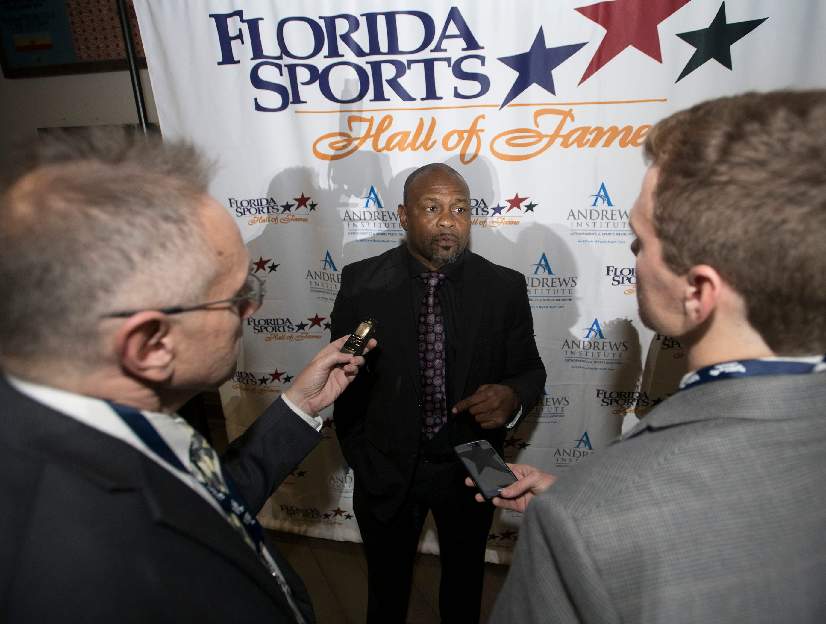 Pensacola boxer Roy Jones, Jr. talks with reporters before the start of Wednesday night's 2018 Florida Sports Hall of Fame Enshrinement Ceremony at the National Naval Aviation Museum.