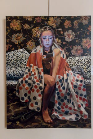 """""""Blue Screen Madonna"""" by Ruta Kamaporis is one of over 100 pieces on display as part of the """"Cinco Banderas Collection"""" at the Artel Gallery on Tuesday, October 30, 2018, and was the only piece chosen to be added to the permanent collection. The exhibit, which runs through November 30, is celebrating its 30th anniversary this year."""
