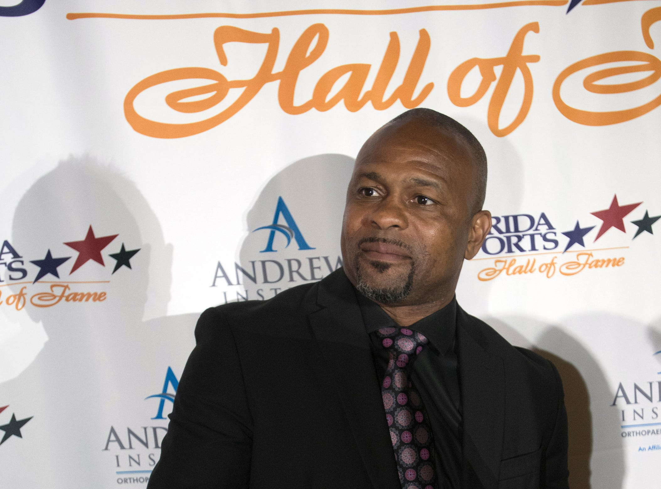 Pensacola boxer Roy Jones, Jr. poses for photographs before the start of Wednesday night's 2018 Florida Sports Hall of Fame Enshrinement Ceremony at the National Naval Aviation Museum.