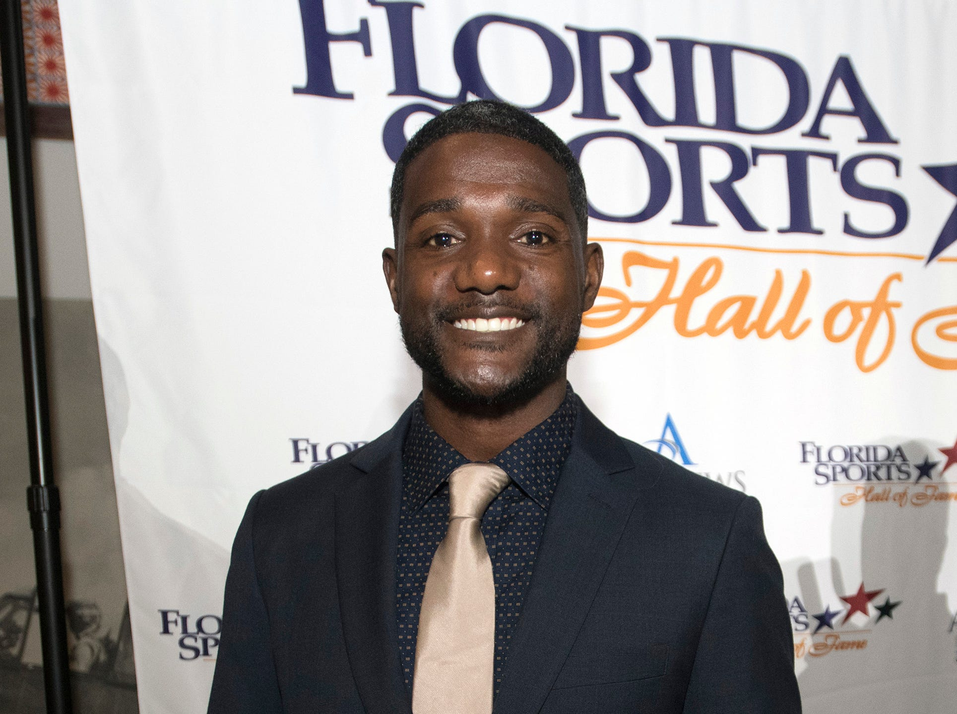 Pensacola own, Justin Gatlin, poses for photographs before the start of Wednesday night's 2018 Florida Sports Hall of Fame Enshrinement Ceremony at the National Naval Aviation Museum.