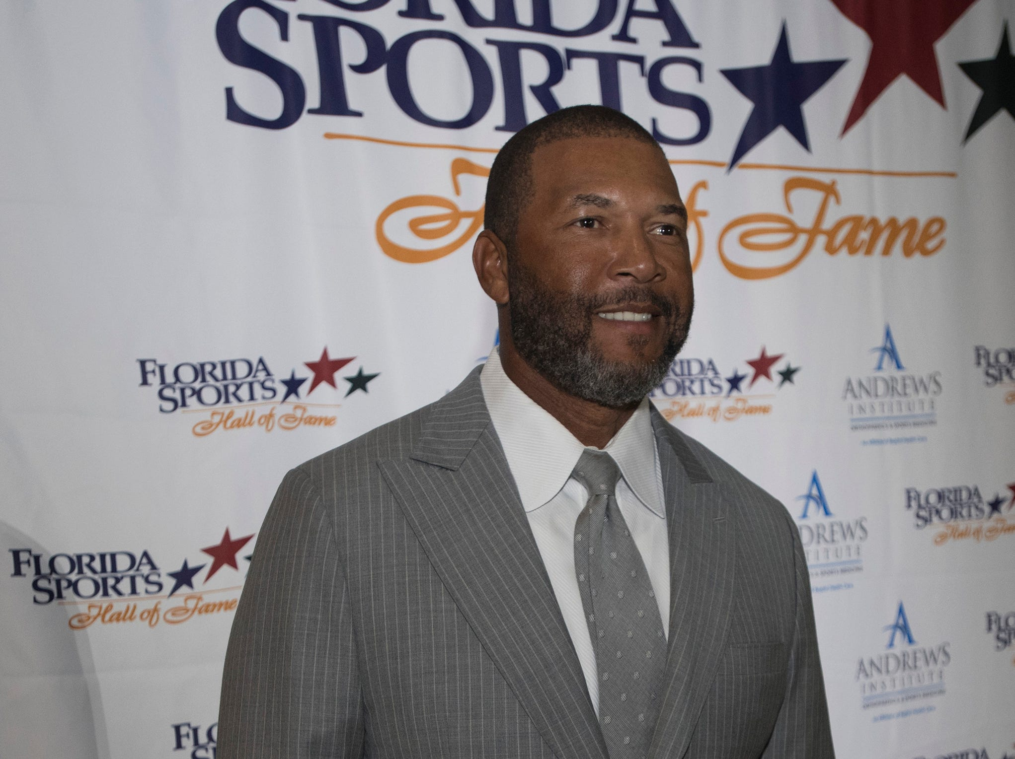 Gary Sheffield pose for photographs before the start of Wednesday night's 2018 Florida Sports Hall of Fame Enshrinement Ceremony at the National Naval Aviation Museum.