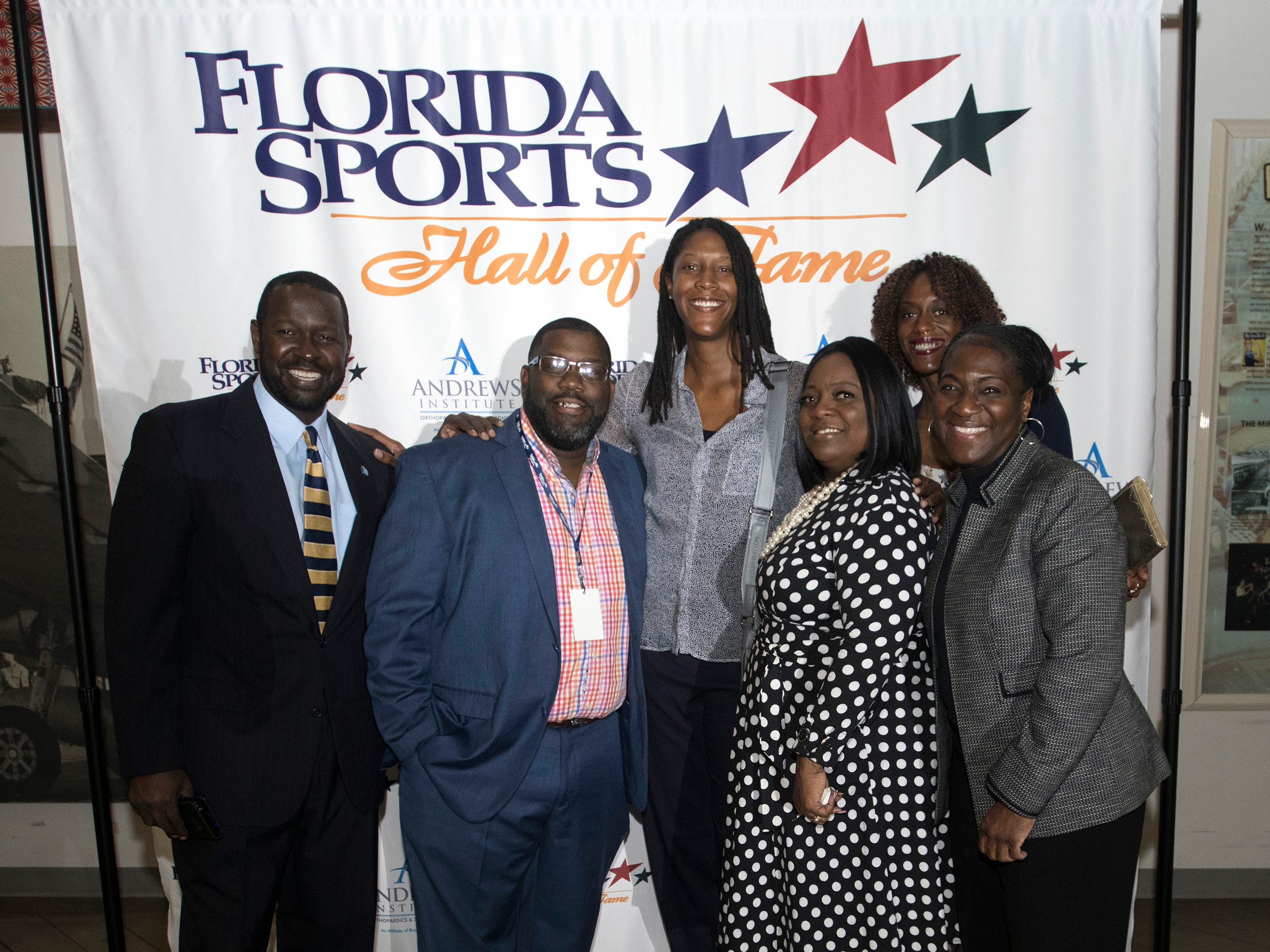 Pensacola own, Michelle Snow and WNBA star pose for photos with friend and family before the start of Wednesday night's 2018 Florida Sports Hall of Fame Enshrinement Ceremony at the National Naval Aviation Museum.