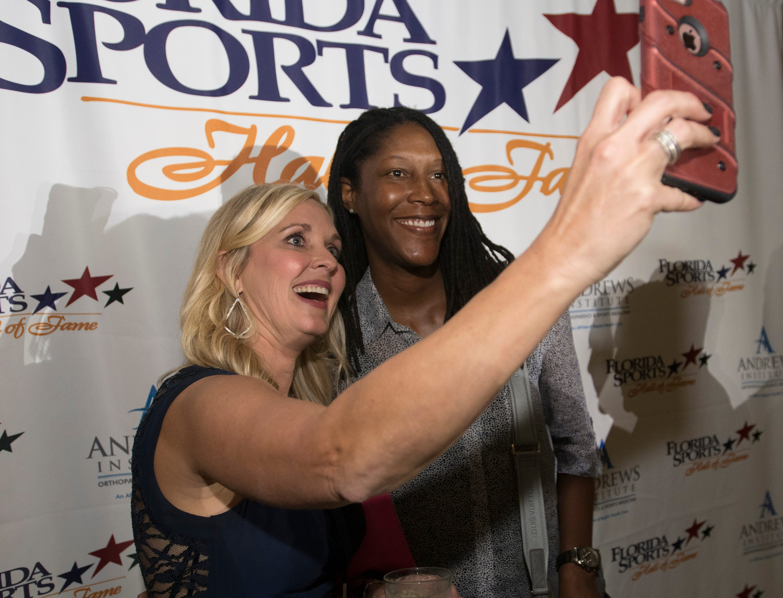 Pensacola own, Michelle Snow and WNBA star poses for photos with Sarah Parker before the start of Wednesday night's 2018 Florida Sports Hall of Fame Enshrinement Ceremony at the National Naval Aviation Museum.