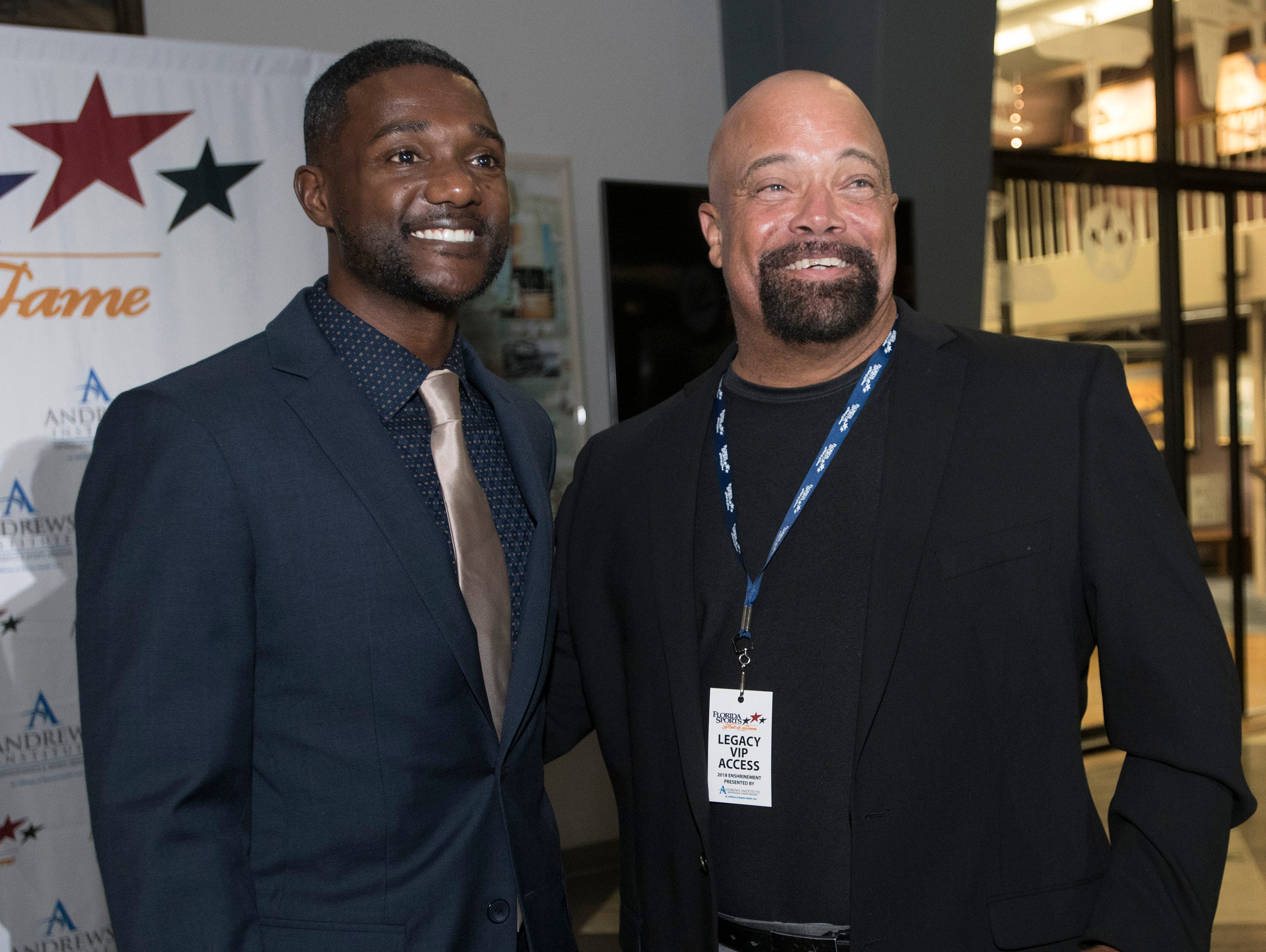 Pensacola own, Justin Gatlin and Adrian Stills pose for photographs before the start of Wednesday night's 2018 Florida Sports Hall of Fame Enshrinement Ceremony at the National Naval Aviation Museum.