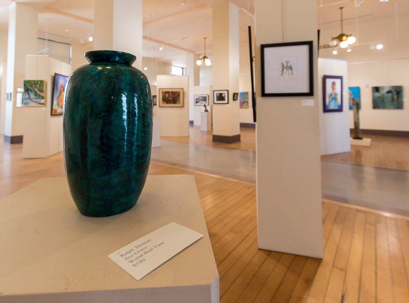 """Sea Grass,"" a wood burl vase by Lukas Mikurda, is one of over 100 pieces on display as part of the ""Cinco Banderas Collection"" at the Artel Gallery on Tuesday, October 30, 2018. The exhibit, which runs through November 30, is celebrating its 30th anniversary this year."