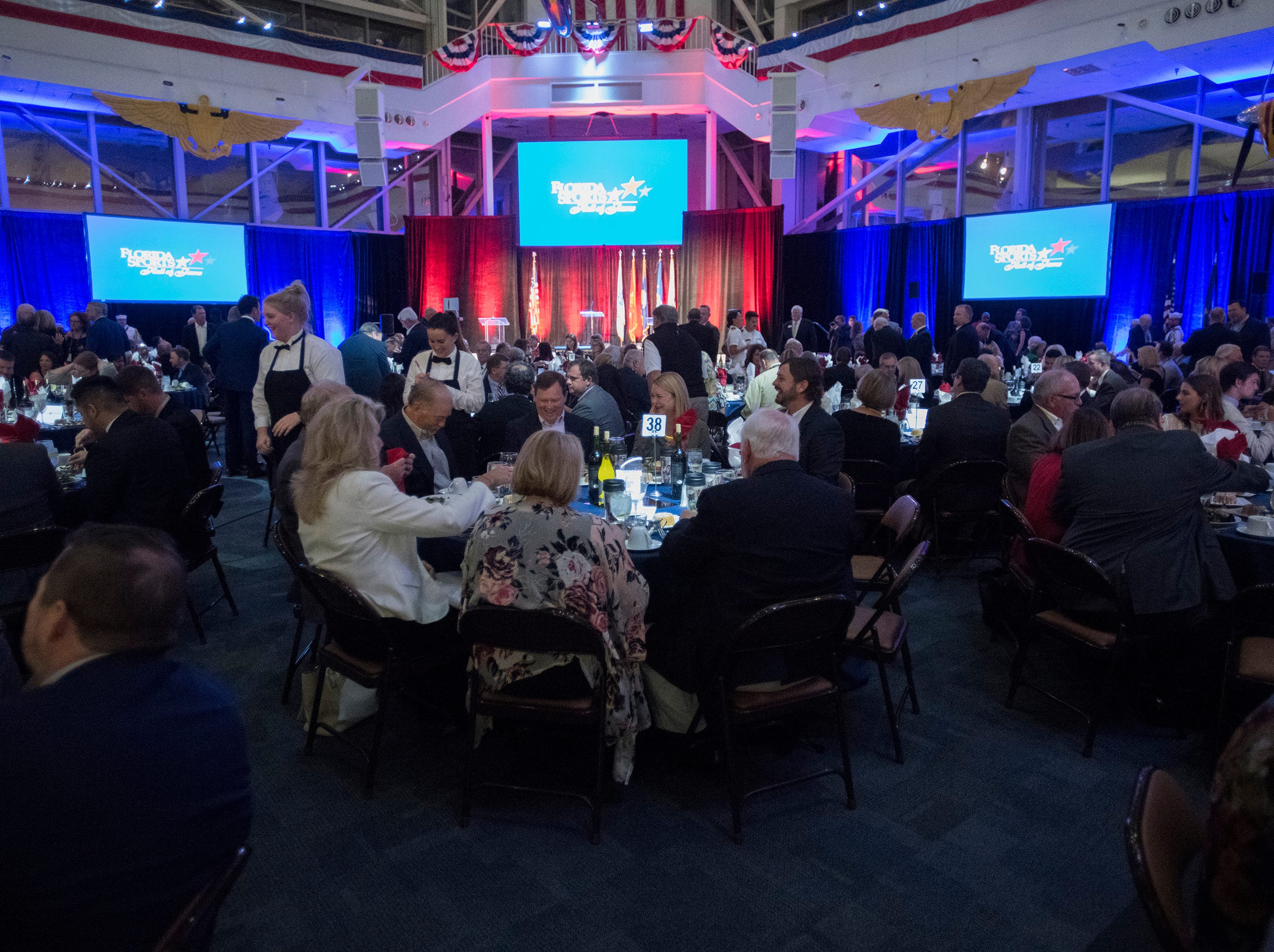 Sports fans, athletes and enthusiasts arrive at the National Naval Aviation Museum on board Naval Air Station Pensacola for the 218 Florida Sports Hall of Fame Enshrinement Ceremony on Wednesday, Nov. 7, 2018.