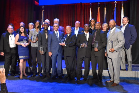 Former Florida State defensive coordinator Mickey Andrews, far left, was honored at the recent Florida Sports Hall of Fame induction ceremony in Pensacola with a lifetime achievement award.