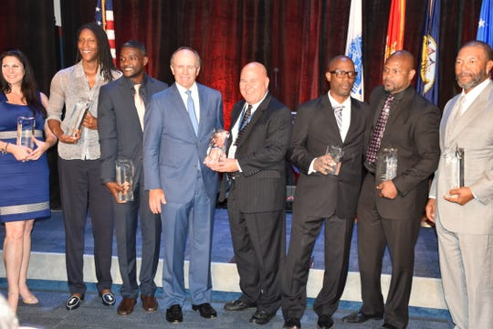 The inductees into Florida Sports Hall of Fame with awards Wednesday night. Left to right: Melissa Pihos, daughter of late Pete Pihos, Michelle Snow, Justin Gatlin, Jerry Pate, Mick Hubert, Lumon May (Fame For Fitness Award), Roy Jones Jr., Gary Sheffield.