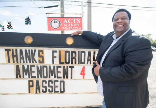 Leon Rankins, director of Another Chance Transitional Services, poses next to a sign thanking Floridians for passing Amendment 4 on Nov. 8.