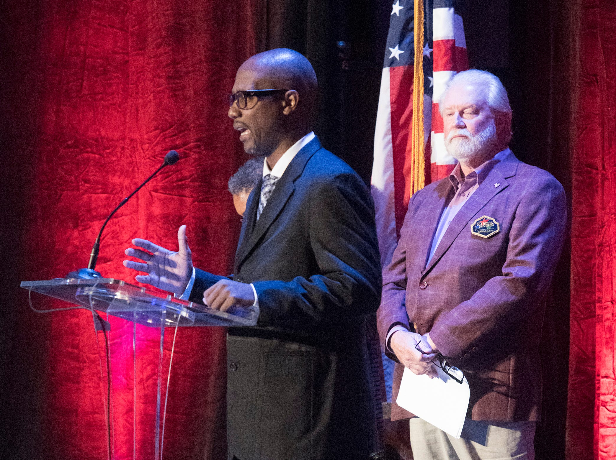 Lumon May accepts the 2018 Fame for Fitness Award on behalf of the Southern Youth Sports Assoc. of Pensacola during the 2018 Florida Sports Hall of Fame Enshrinement Ceremony at the National Naval Aviation Museum on Wednesday, Nov. 7, 2018.
