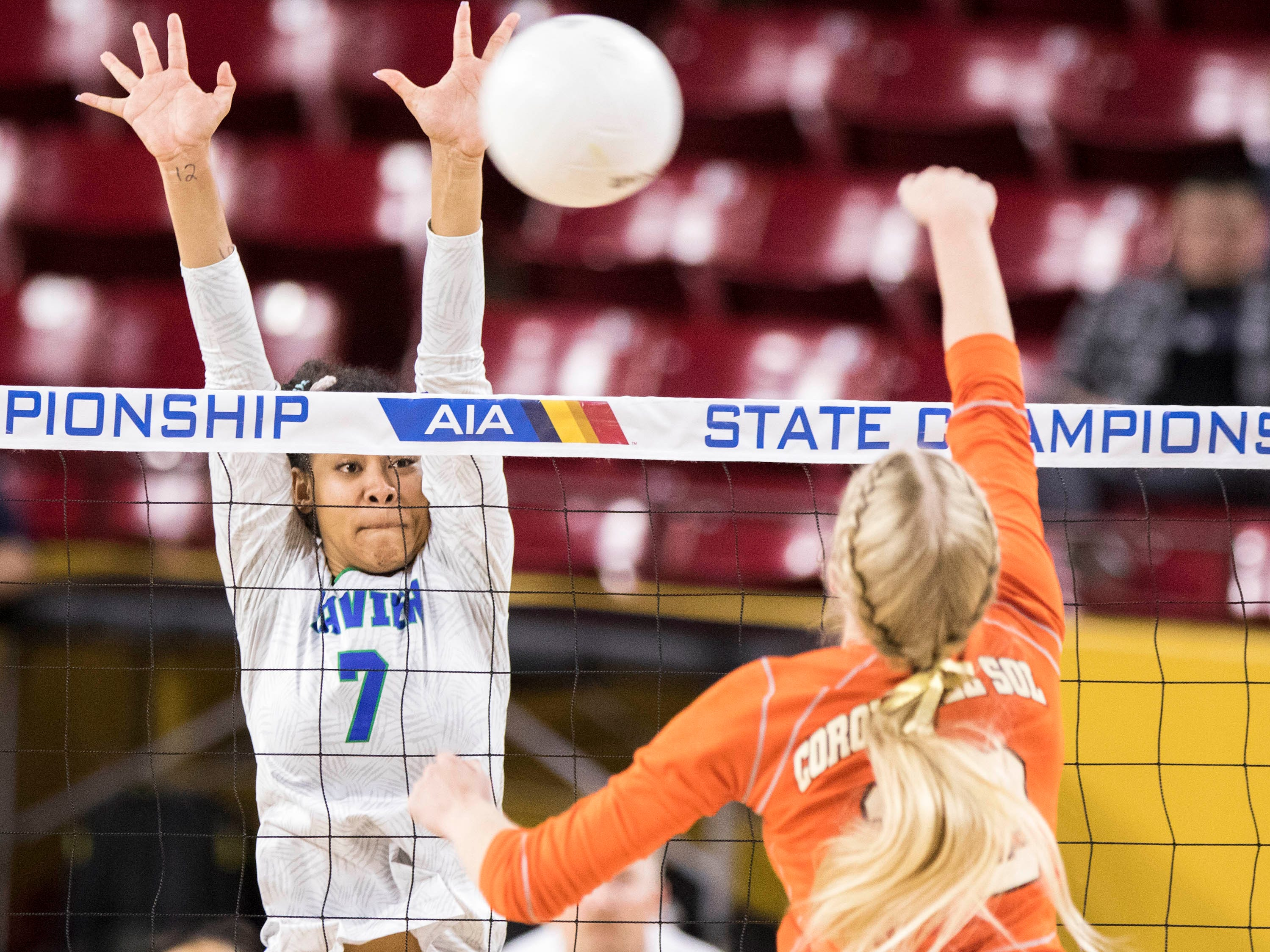 Xavier's Briana McKnight defends a shot from Corona del Sol's Nicole Newlin during the girls 6A volleyball state championship at Wells Fargo Arena in Tempe, Wednesday, Nov. 7, 2018.