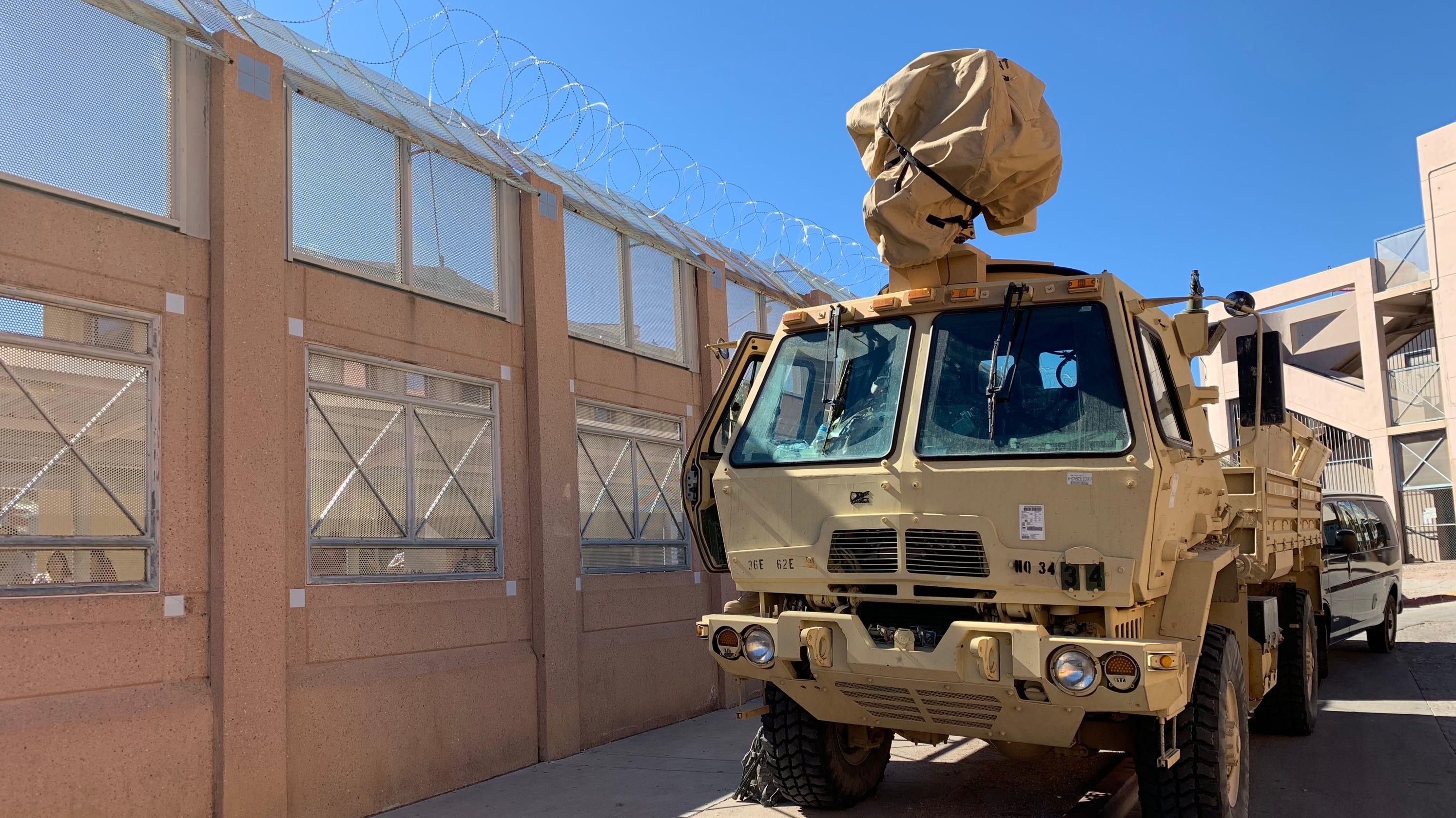 Migrant Caravan Troops Install Barbed Wire At Nogales