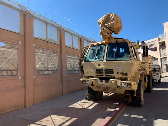 A U.S. Army vehicle is parked Nov. 7, 2018, in front of the border fence in downtown Nogales. Troops deployed to the Arizona border installed the barbed wire atop the fence in anticipation of the potential arrival of a migrant caravan.