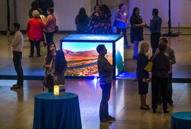 People peruse a display at the Phoenix Art Museum for the Water Public Art Challenge, Wednesday, November 7, 2018.