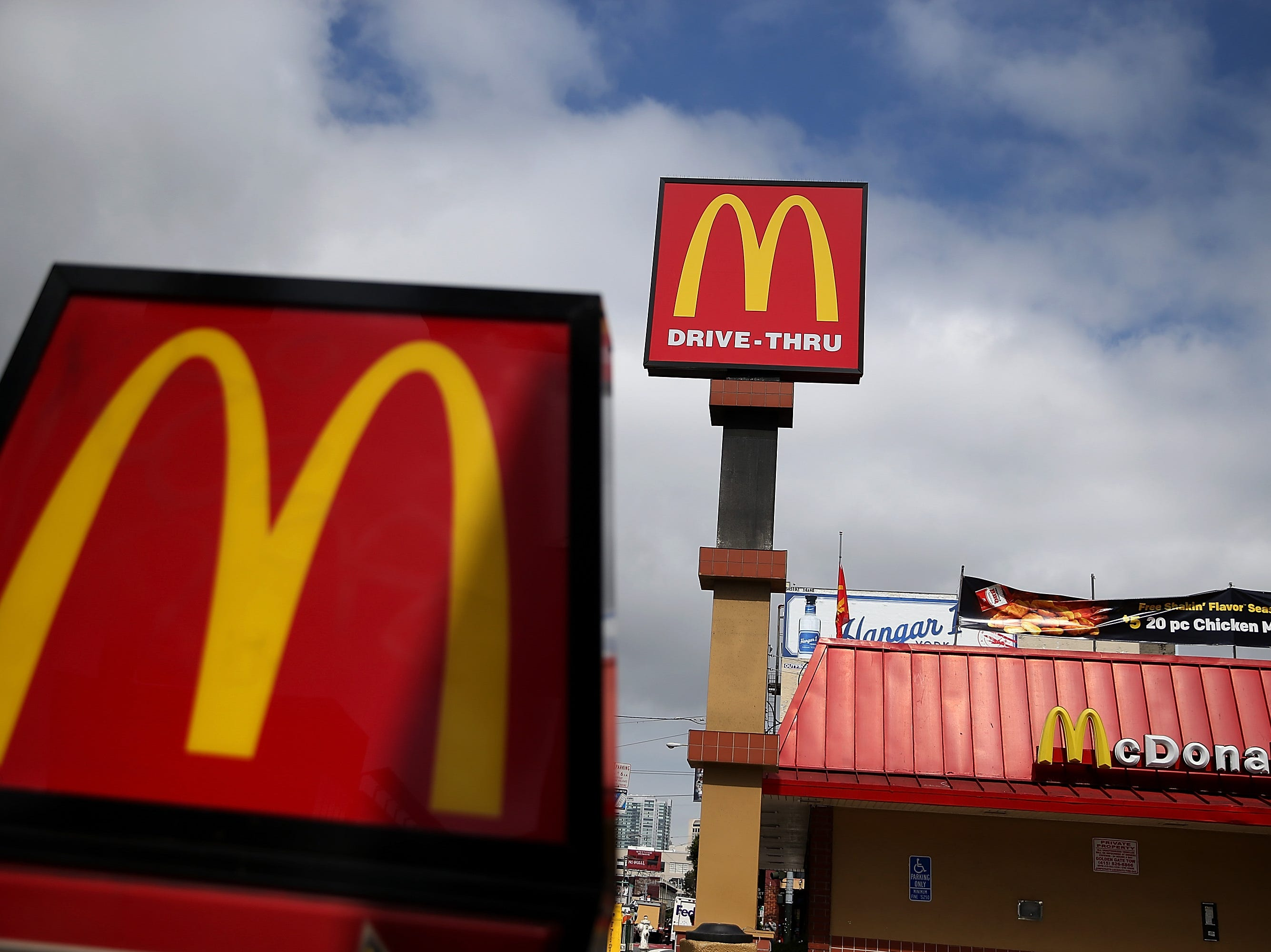 SAN FRANCISCO, CA - APRIL 22:  Signs are posted on the exterior of a McDonald's restaurant on April 22, 2015 in San Francisco, California. McDonald's reported a decline in first quarter revenues with a profit of $811.5 million, or 84 cents a share compared to $1.2 billion, or $1.21 a share, one year ago.  (Photo by Justin Sullivan/Getty Images)