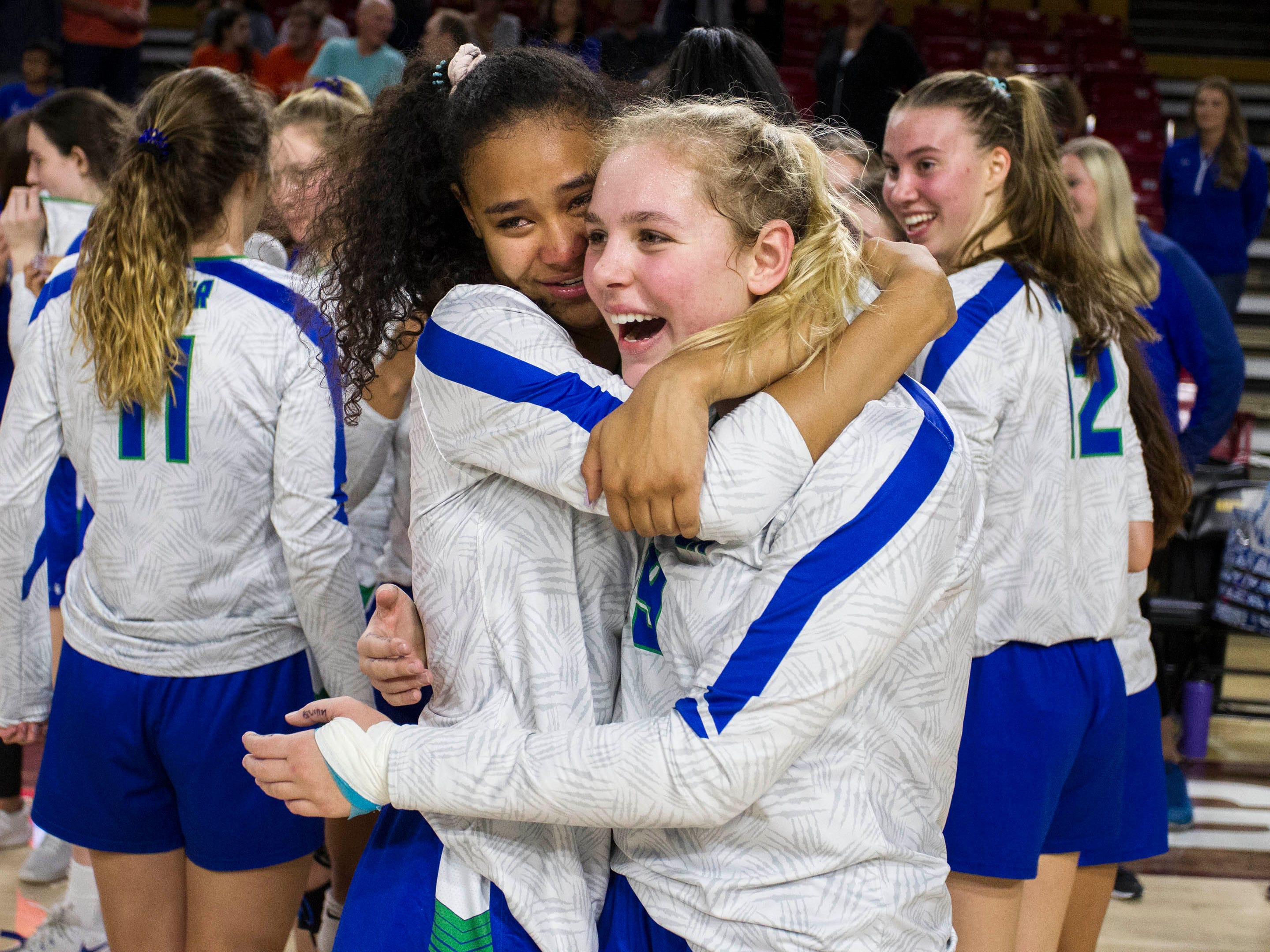 Xavier players Briana McKnight and Shannon Shields hug as they celebrate their three set win over Corona del Sol in the girls 6A volleyball state championship at Wells Fargo Arena in Tempe, Wednesday, Nov. 7, 2018.