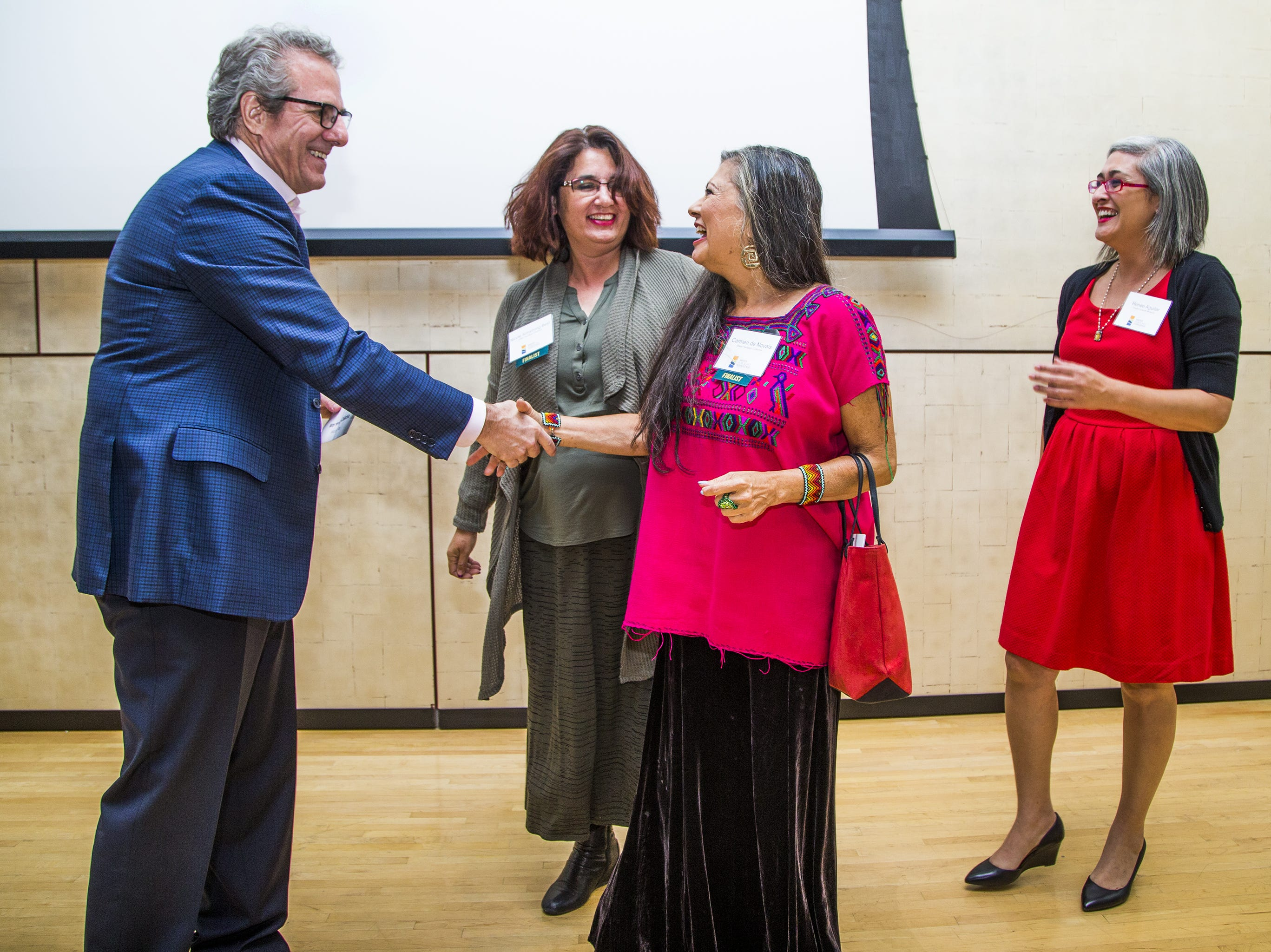 Steve Seleznow, president and CEO of the Arizona Community Foundation, left, presents a $50,000 check to the Water Heritage Collective team that created Portal to the Past as their entry for the Water Public Art Challenge. From left to right are; Seleznow, Nicole Armstrong-Best, Carmen Guerrero and Renee Aguilar. The team was one of five that received $50,000 each to realize their project.