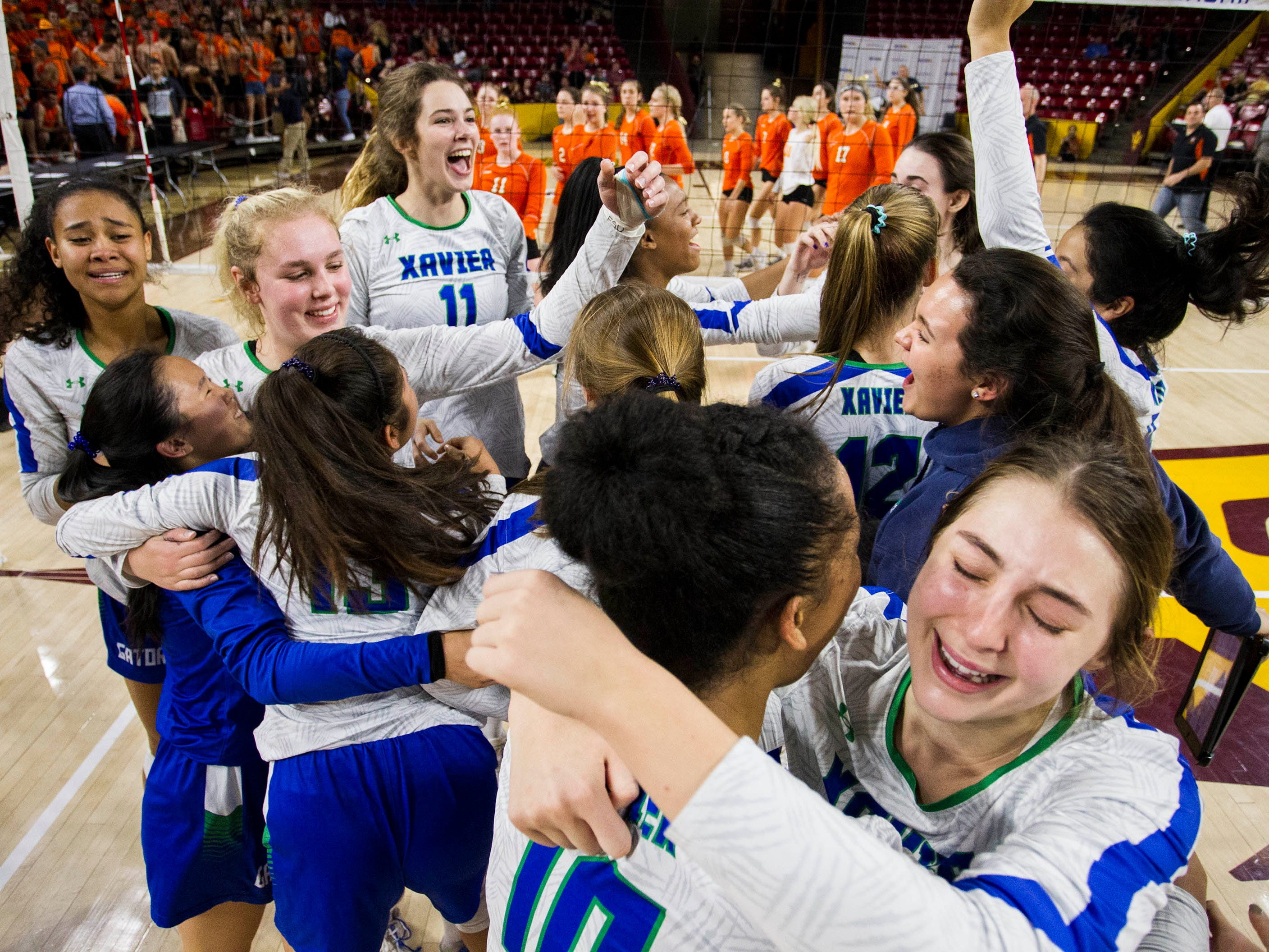 Xavier players celebrate their three set win over Corona del Sol in the girls 6A volleyball state championship at Wells Fargo Arena in Tempe, Wednesday, Nov. 7, 2018.