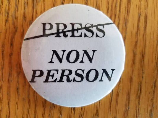 Non-person button