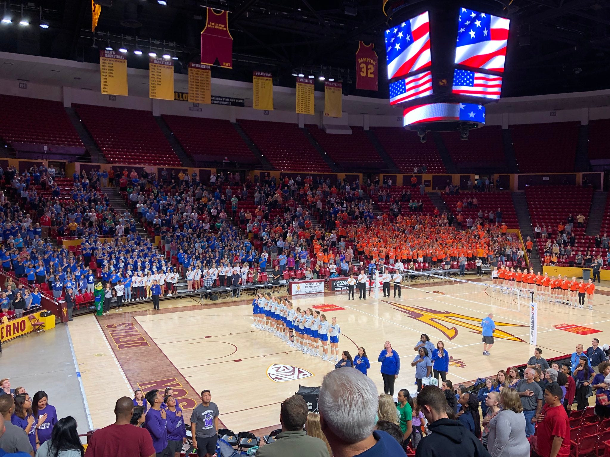 Xavier and Corona stand for the National Anthem prior to the 6A girls volleyball crown at Wells Fargo Arena in Tempe on Nov. 7, 2018.