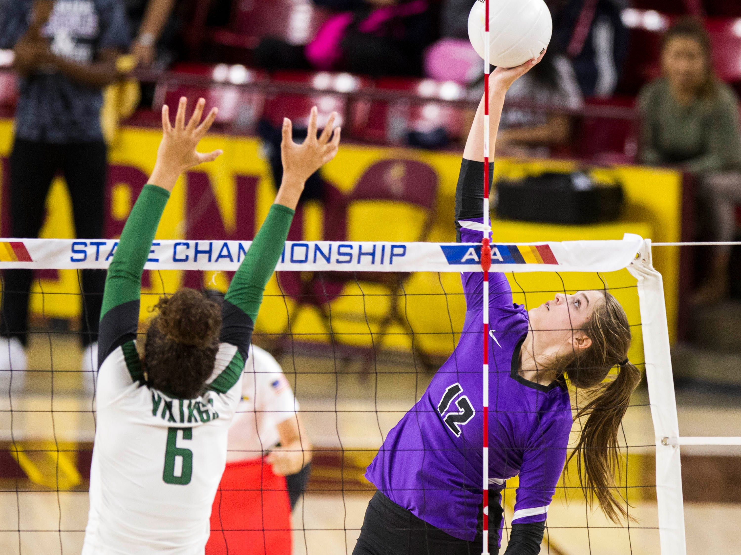Millennium's Ashley Antoniak flips it back over the net against Sunnyslope's Madi McGill in the girls 5A volleyball state championship at Wells Fargo Arena in Tempe, Wednesday, Nov. 7, 2018.