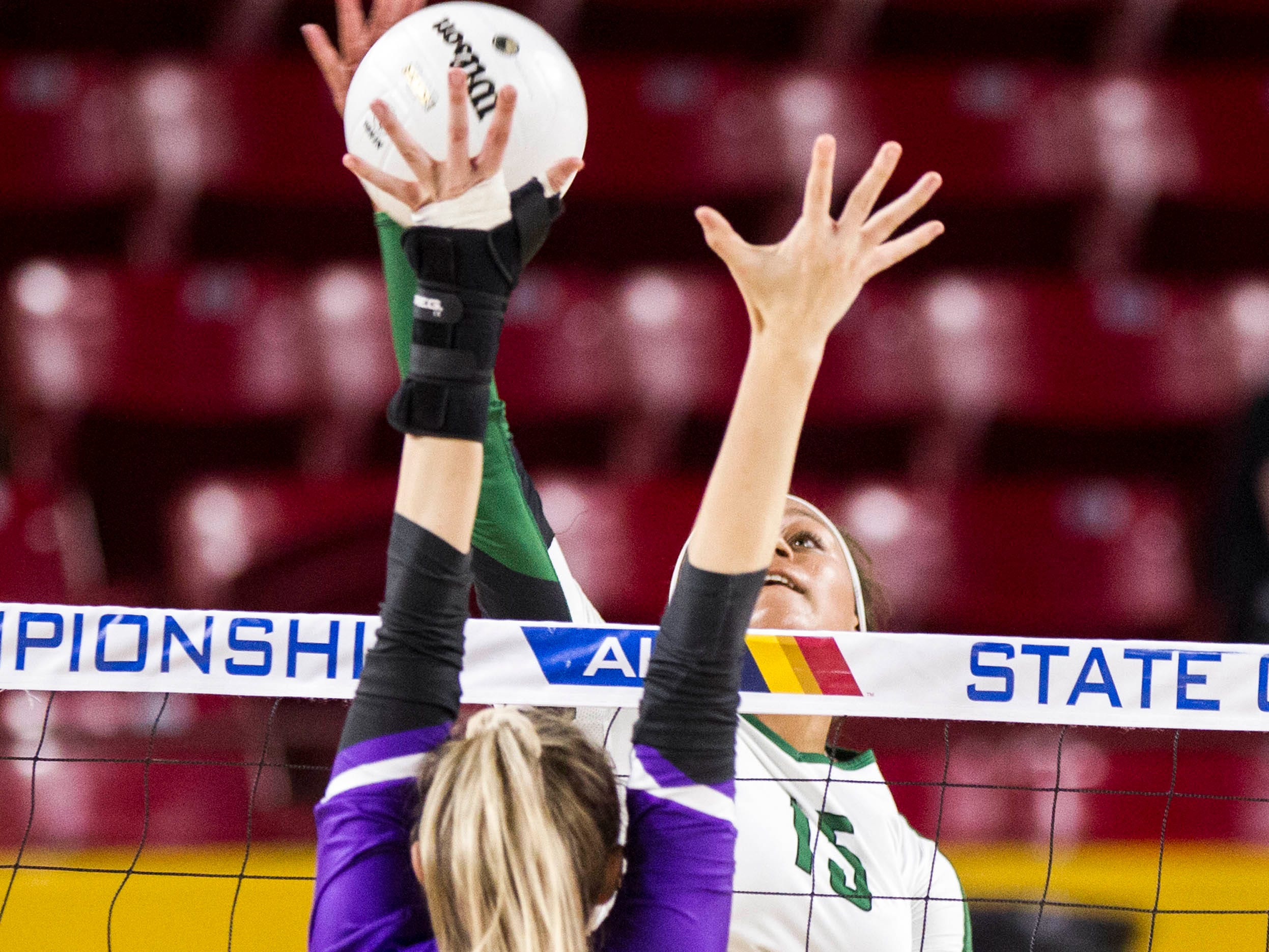 Sunnyslope's Jazmyn Wheeler eyes a shot past  Millennium's Jordan Miller in the girls 5A volleyball state championship at Wells Fargo Arena in Tempe, Wednesday, Nov. 7, 2018.