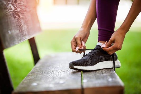 Woman Tying Shoes