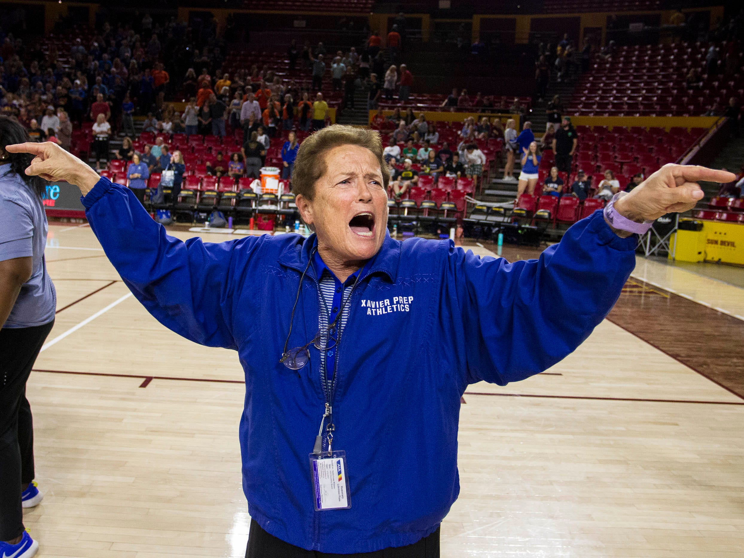 Xavier Athletic Director Sister Lynn Winsor does her part in their win over Corona del Sol's in the girls 6A volleyball state championship at Wells Fargo Arena in Tempe, Wednesday, Nov. 7, 2018.