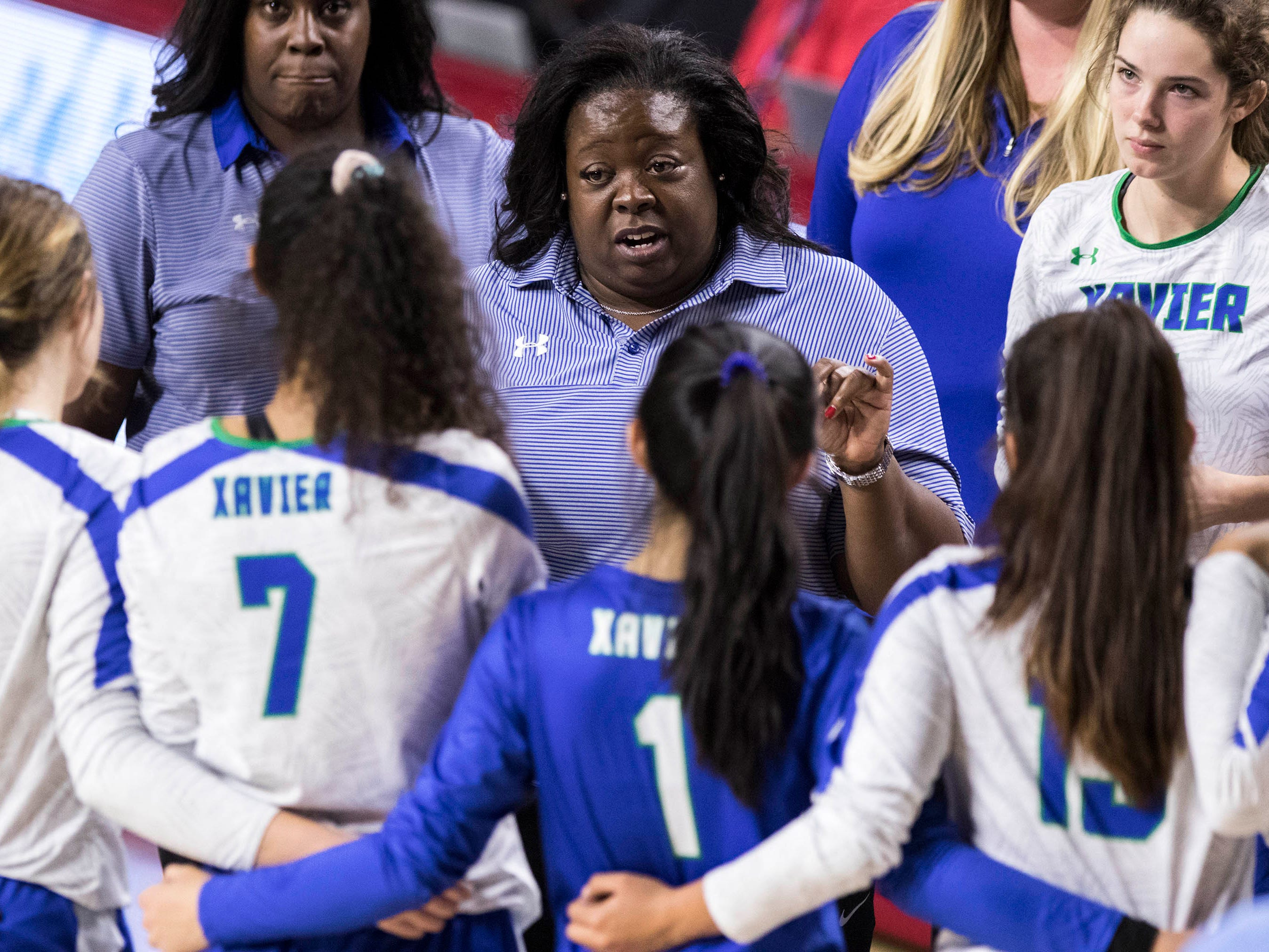 Xavier coach Lamar-Renee BryantÊtalks to her team as they play Corona del Sol's in the girls 6A volleyball state championship at Wells Fargo Arena in Tempe, Wednesday, Nov. 7, 2018.