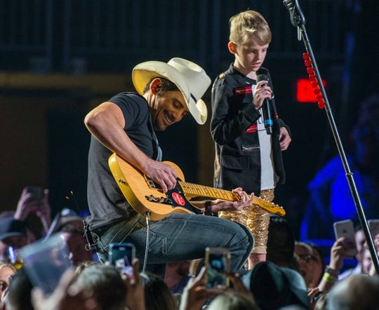 Brad Paisley and Vedder Gabriel sharing the spotlight.