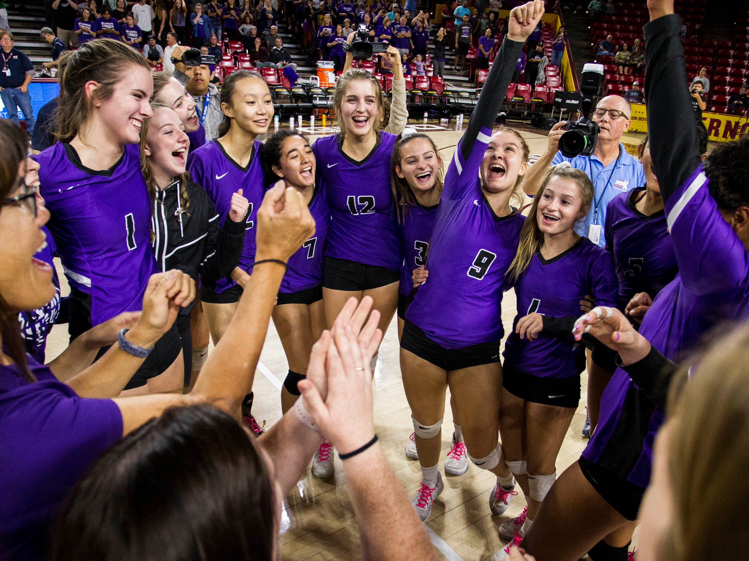 Millennium's players celebrate their three set 5A State Championship win over Sunnyslope in the girls 5A volleyball state championship at Wells Fargo Arena in Tempe, Wednesday, Nov. 7, 2018.