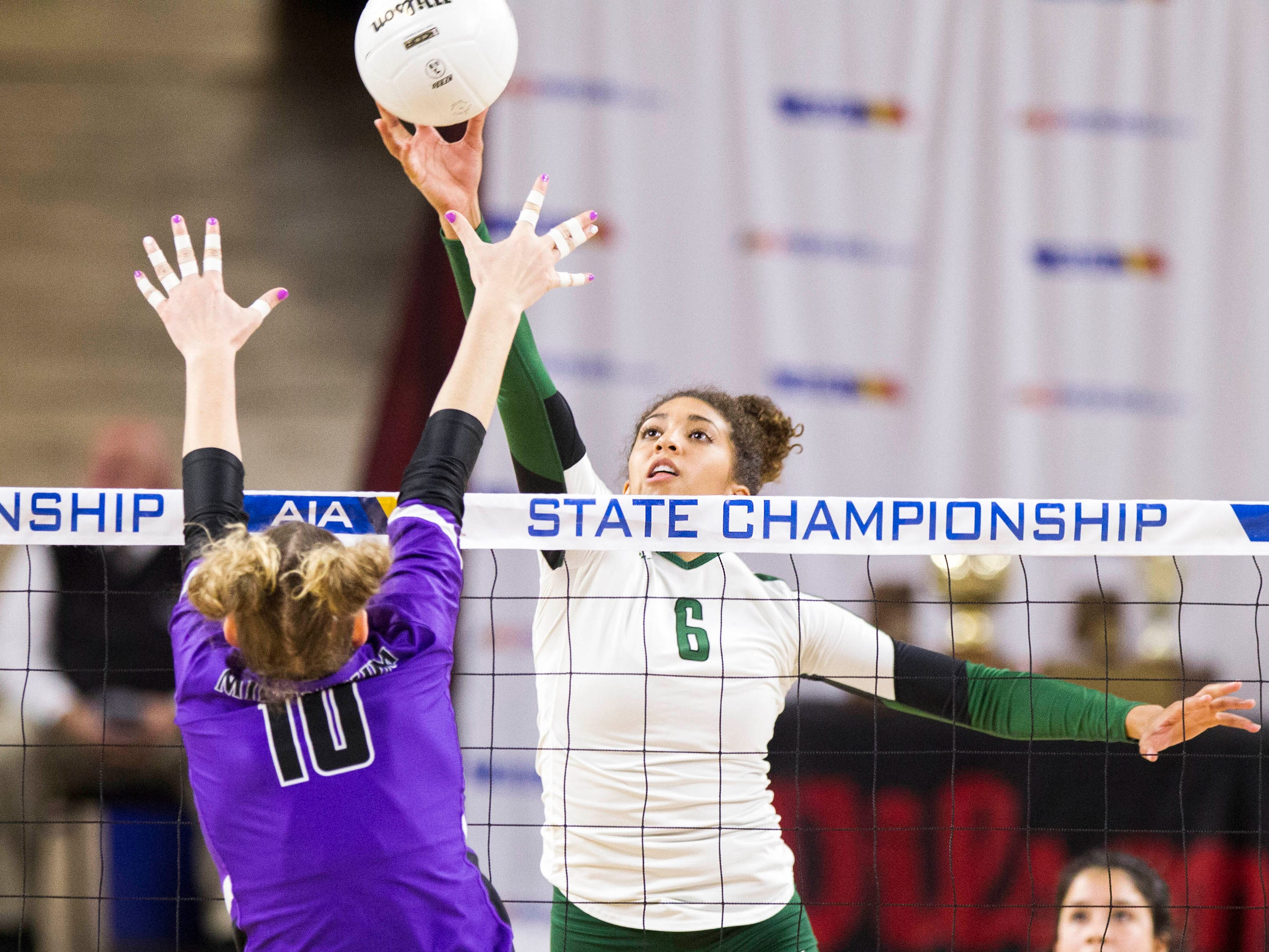 Sunnyslope's Madi McGill tips it past Millennium's Rylee Johnson in the girls 5A volleyball state championship at Wells Fargo Arena in Tempe, Wednesday, Nov. 7, 2018.