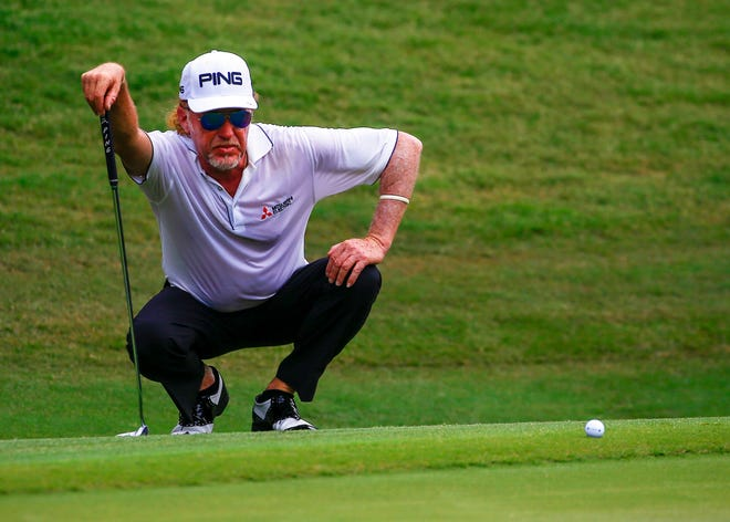 Miguel Angel Jimenez lines up his putt on the second green during the final round of the Regions Tradition PGA Champions Tour golf tournament, Sunday, May 20, 2018, in Birmingham, Ala.