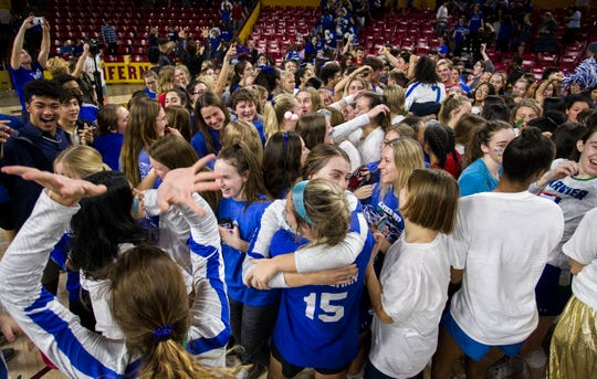 Xavier players celebrate with their fans after their three set win over Corona del Sol in the girls 6A volleyball state championship at Wells Fargo Arena in Tempe, Wednesday, Nov. 7, 2018.