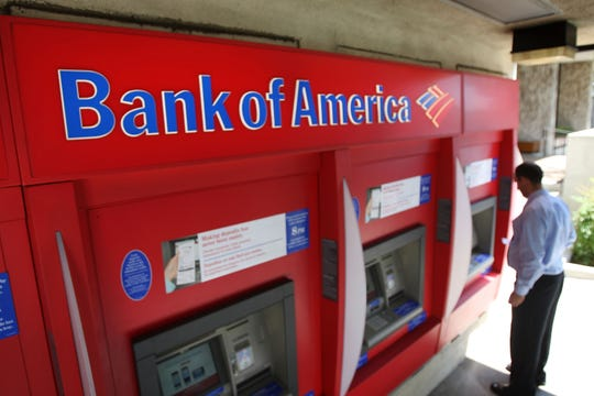 A man uses an ATM at a Bank of America branch on July 28, 2009 in Pasadena, California.