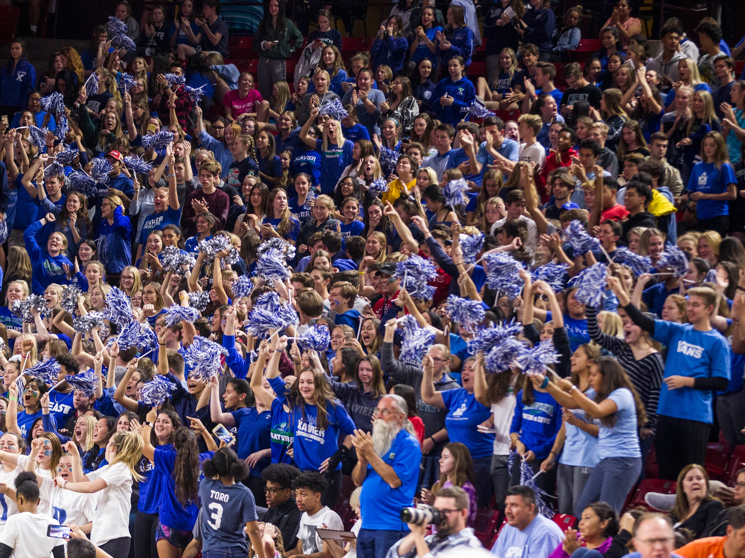 Xavier's fans cheer on their team as they play Corona del Sol's in the girls 6A volleyball state championship at Wells Fargo Arena in Tempe, Wednesday, Nov. 7, 2018.