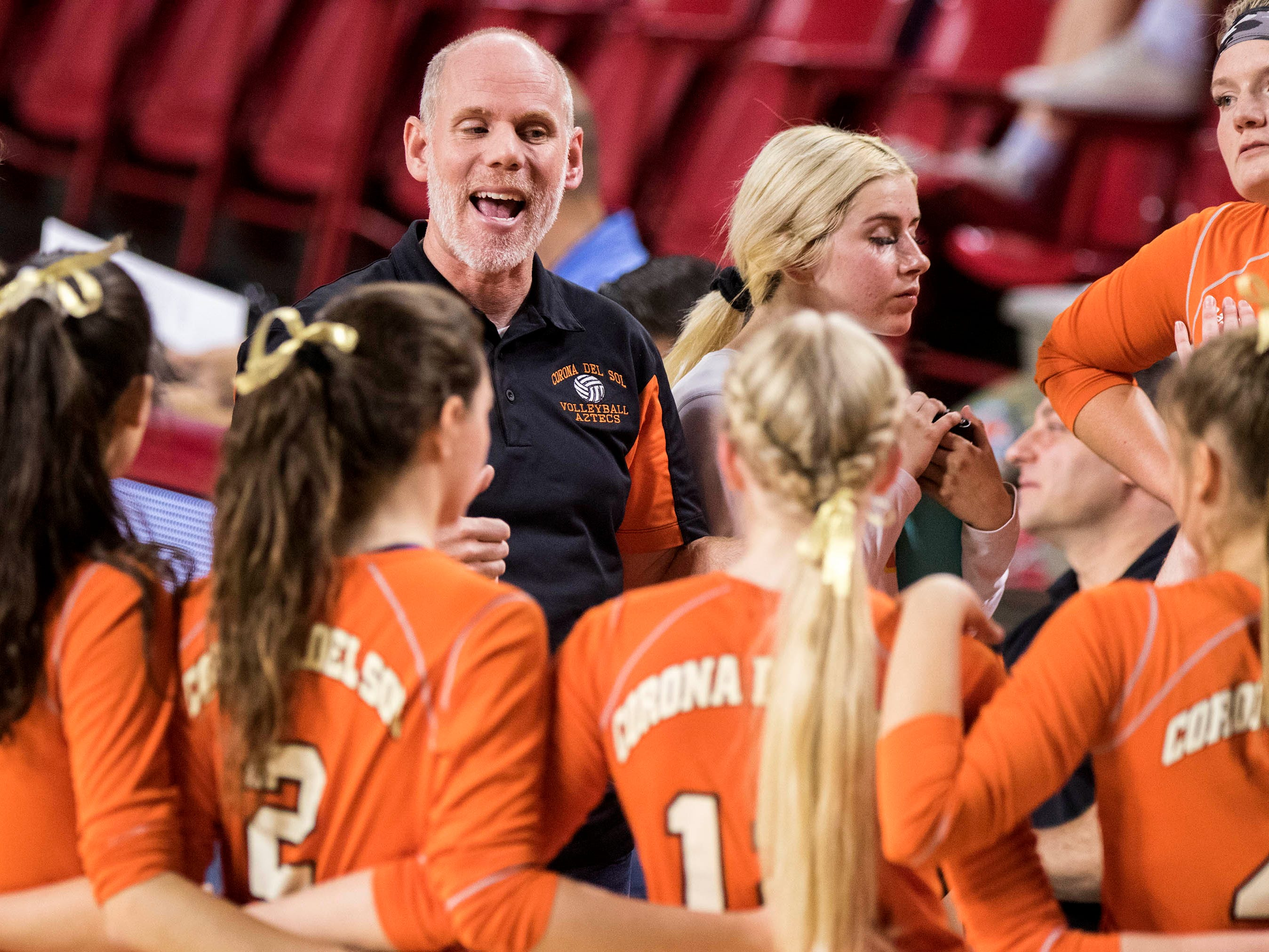 Corona del Sol coach Ben Maxfield talks to his team as they play Xavier in the girls 6A volleyball state championship at Wells Fargo Arena in Tempe, Wednesday, Nov. 7, 2018.