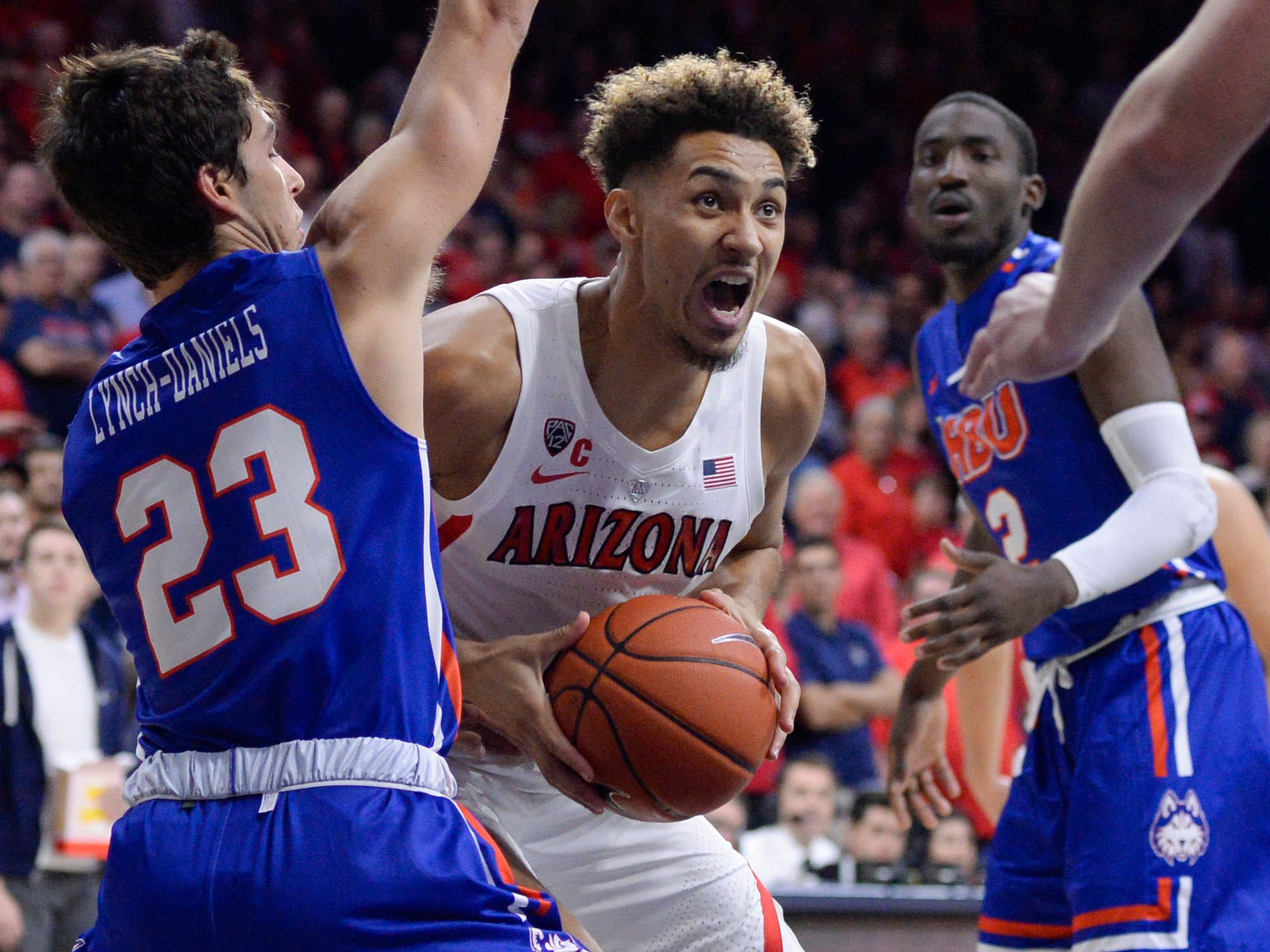 Nov 7, 2018; Tucson, AZ, USA; Arizona Wildcats center Chase Jeter (4) looks to shoot as Houston Baptist Huskies guard Oliver Lynch-Daniels (23) defends during the second half at McKale Center. Mandatory Credit: Casey Sapio-USA TODAY Sports