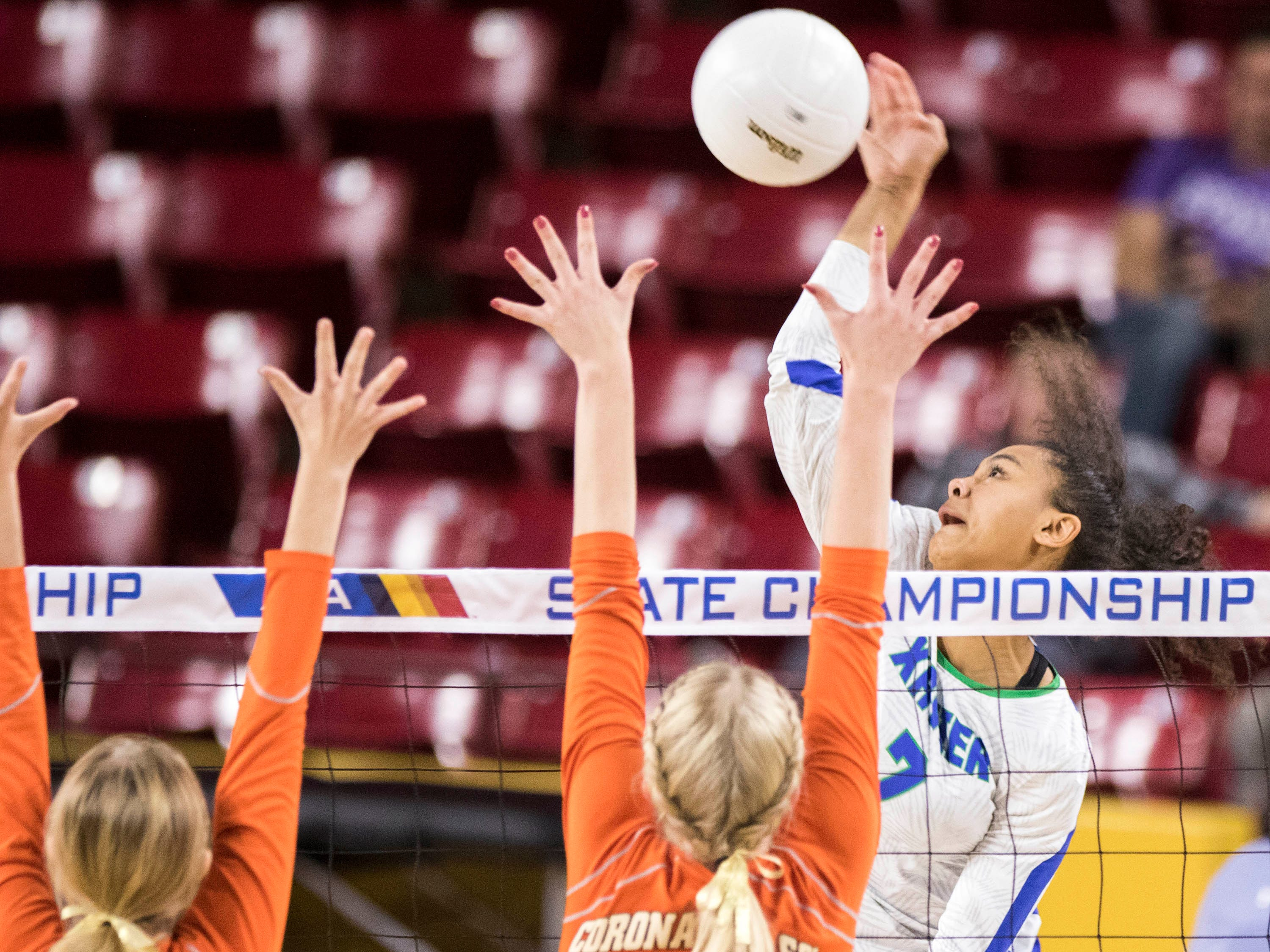Xavier's Briana McKnight takes  a shot at the Corona del Sol's defense during the girls 6A volleyball state championship at Wells Fargo Arena in Tempe, Wednesday, Nov. 7, 2018.