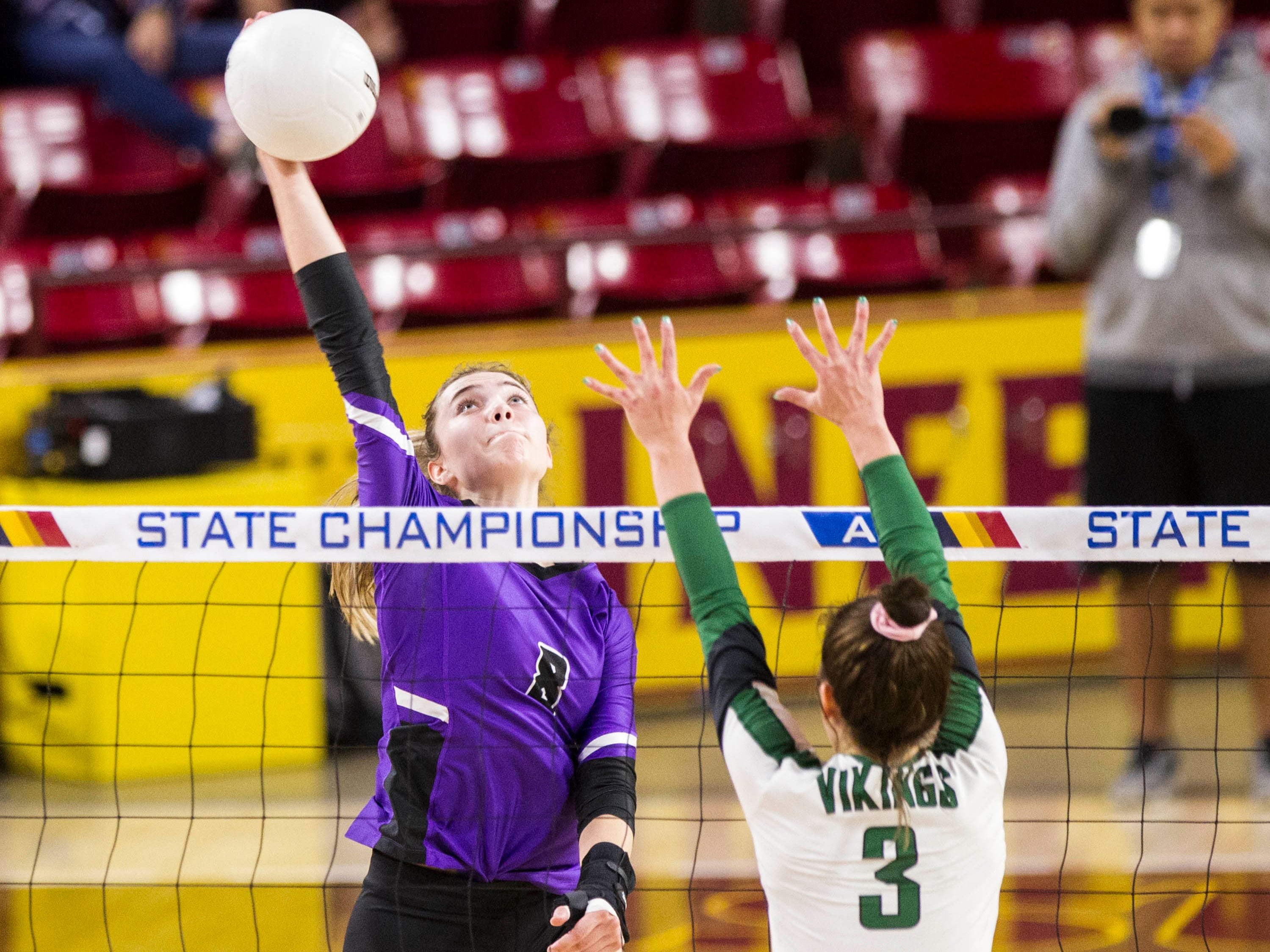 Millennium's Jordan Miller spikes it past Sunnyslope's  Maddie Shepston in the girls 5A volleyball state championship at Wells Fargo Arena in Tempe, Wednesday, Nov. 7, 2018.
