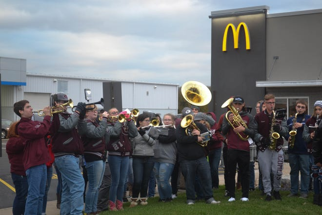 The Genoa High School Marching Band performed on the front lawn during the Genoa McDonald's grand reopening. A portion of the night's sales were donated to the band.