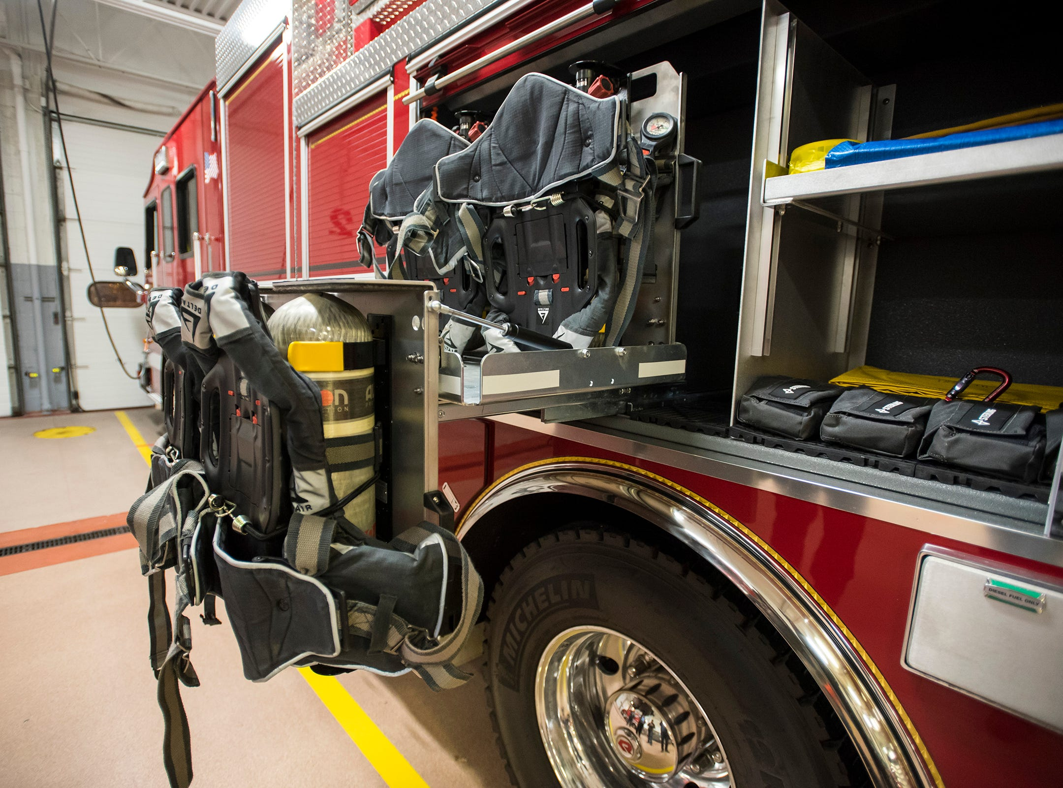 Air tanks can be slid out on a rack and pulled directly onto a standing firefighter's back. Previously tanks were mounted to the wall of the truck and firefighters would have to lift and carry them down, which lead to twisting injuries to firefighters' backs.