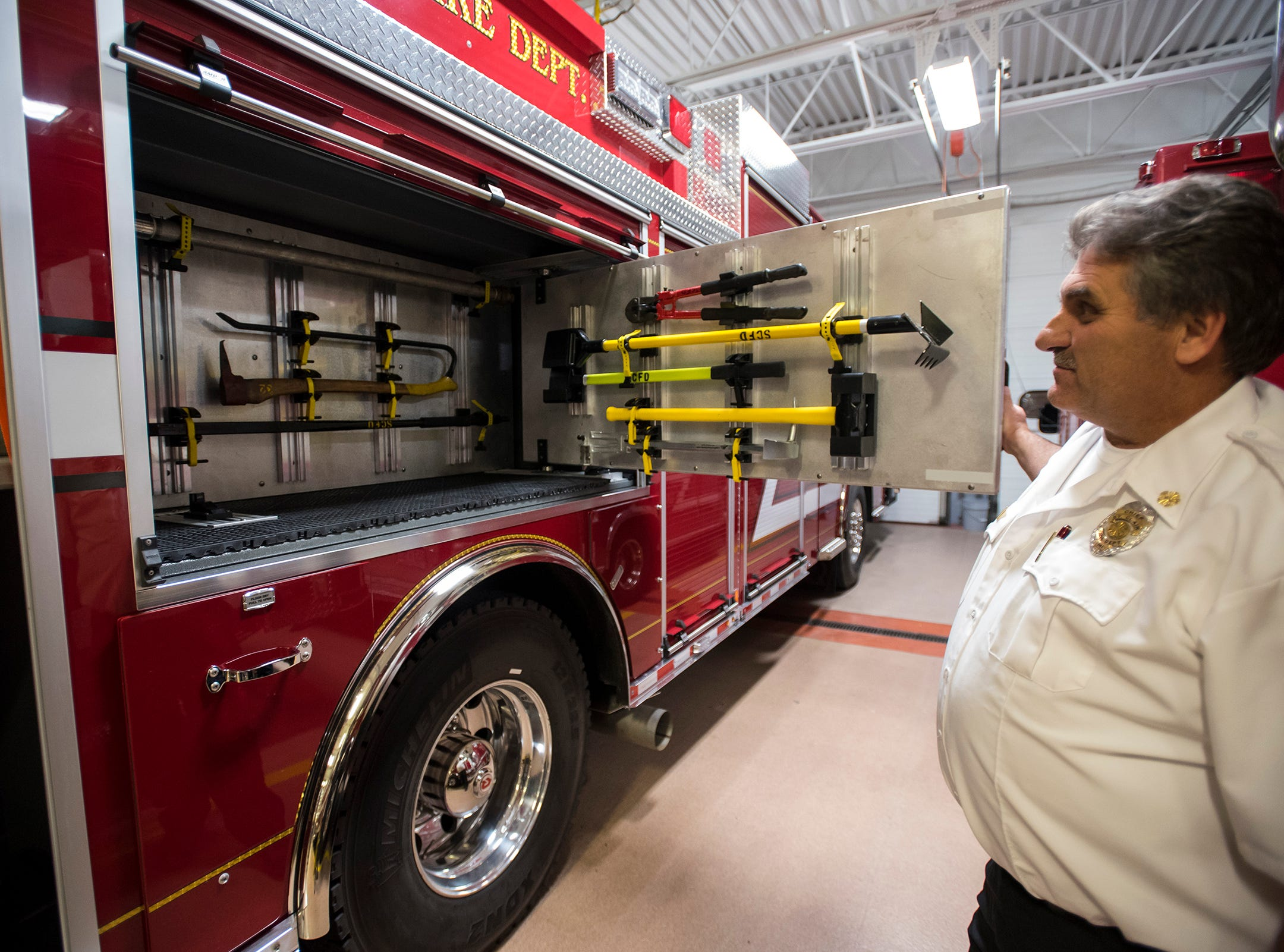 St. Clair Fire Authority Chief David Westrick opens a side compartment on the St. Clair Fire Department's new truck Wednesday, Nov. 7, 2018. The truck carries all of the normal equipment including ladders, tools and bail out bags.