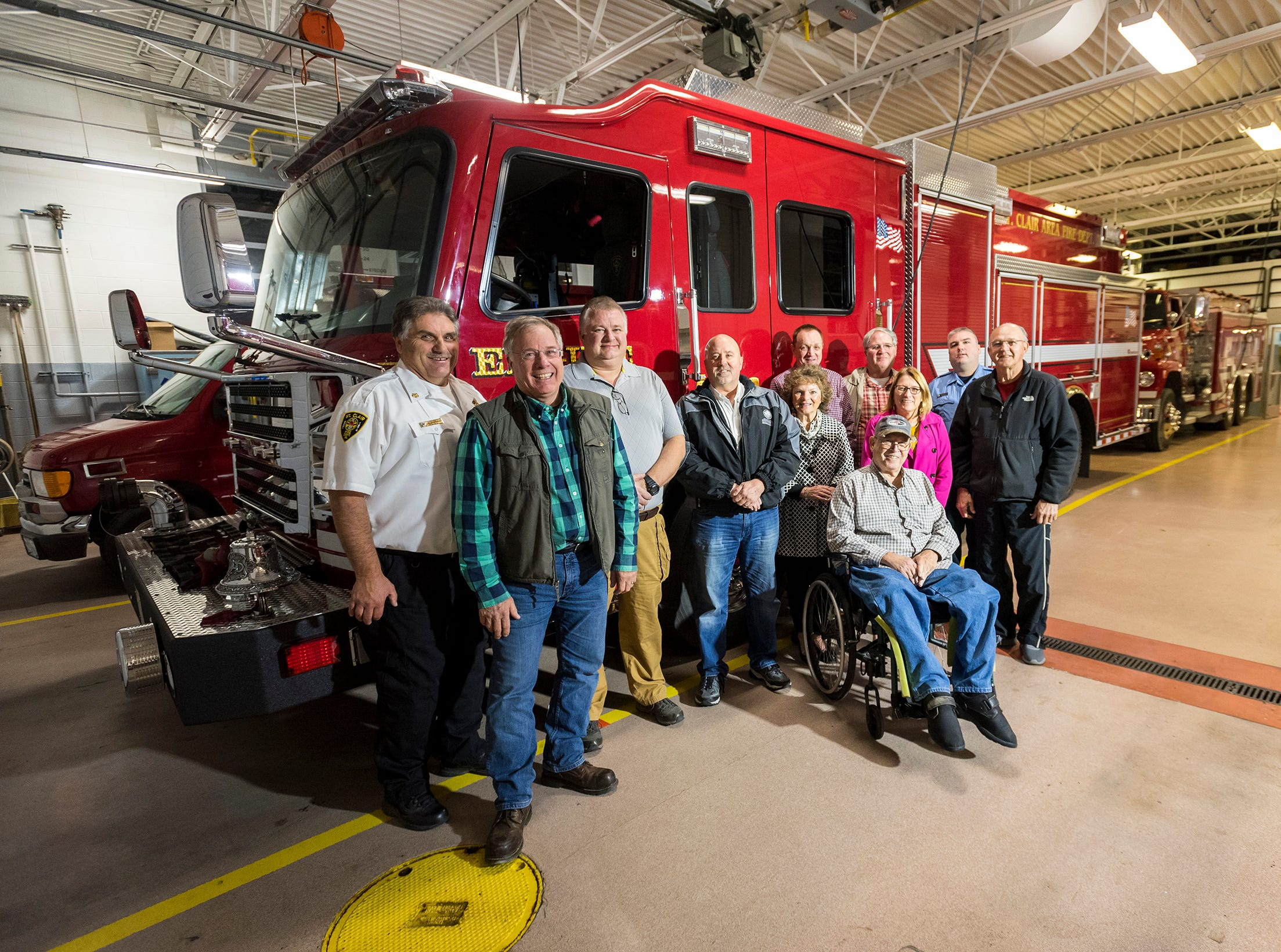 The St. Clair Area Fire Authority Board, pictured with the St. Clair Fire Department's new Rosenbauer pumper truck Wednesday, Nov. 7, 2018 in the fire station. The St. Clair Area Fire Authority began the design process for the truck about two years ago, and the customization process was handled by a committee within the fire authority. The department took possession of the truck in September and took it on its first run Monday.