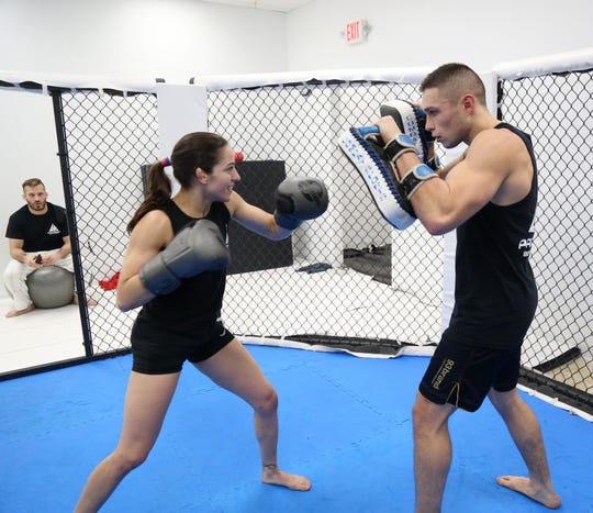 Owner of Precision Boxing & MMA Brian McLaughlin observes Mixed Martial Arts fighter Lindsey VanZandt spar with Garrett Volpe in the Town of Poughkeepsie on November 7, 2018.