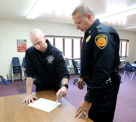 From left Arlington Fire District firefighter paramedic Seth Goldstein and Town of Poughkeepsie Police lieutenant Joseph Cavaliere discuss a plan during an active shooter training session in the Town of Poughkeepsie on November 8, 2018.