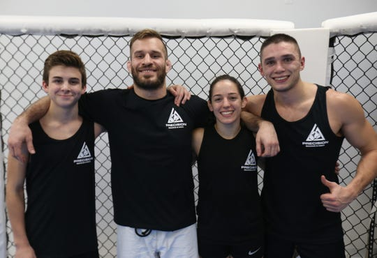 From left, Mixed Martial Arts fighters Jack Frustace, Brian McLaughlin, Lindsey VanZandt and Garrett Volpe at Precision Boxing & MMA in the Town of Poughkeepsie on November 7, 2018.