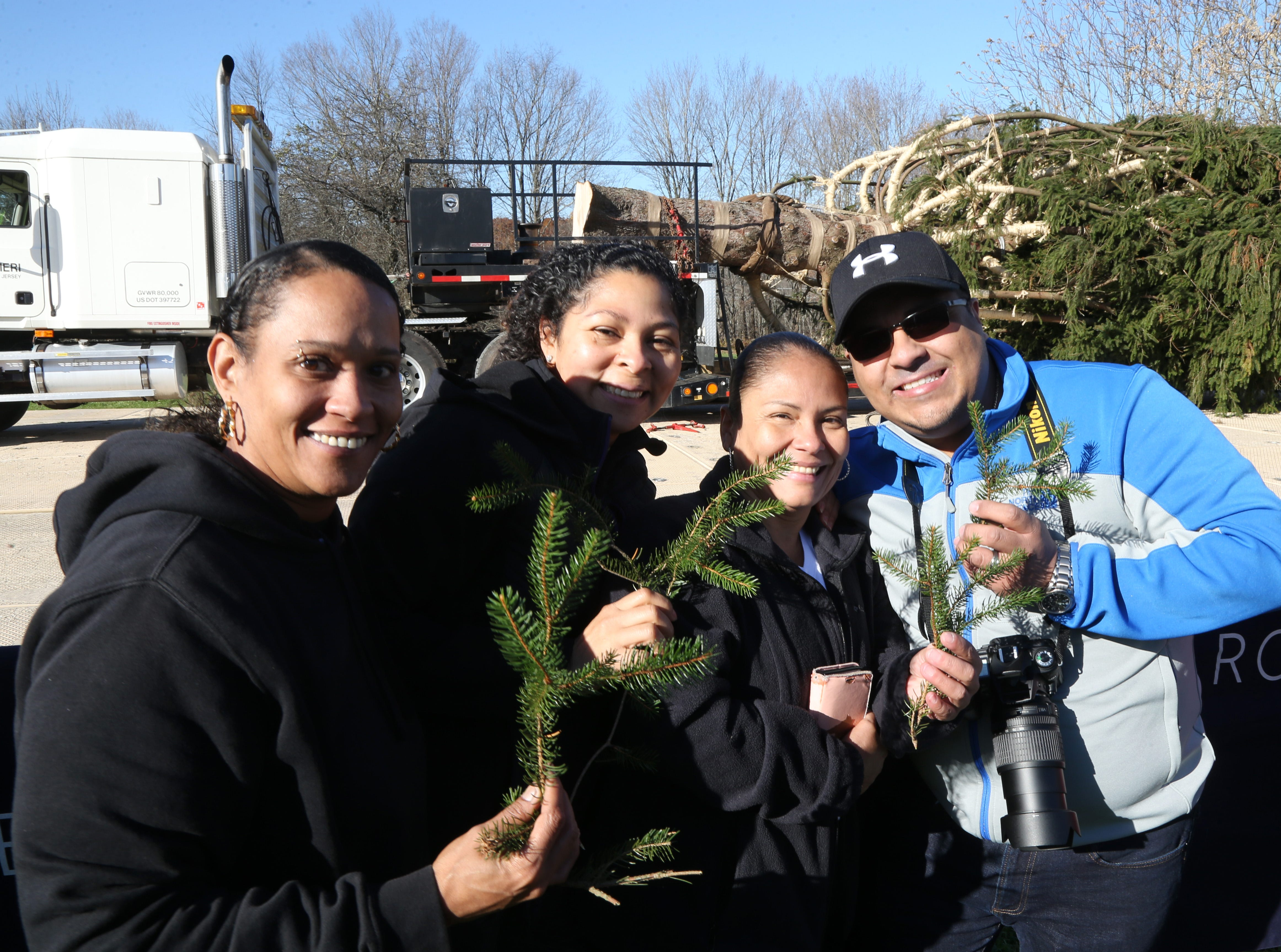 From left, Lee Pabon, Mariluz Garcia, Ledis Ortiz and Marte Garcia of Plattekill with sprigs from the Norway Spruce tree ithat was harvested to be the 2018 Rockefeller Center Christmas Tree in Wallkill on November 8, 2018.