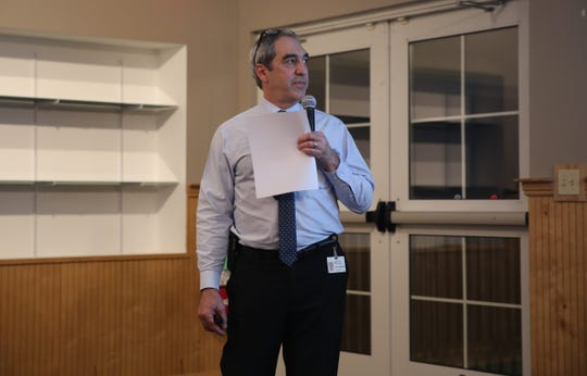 John Maserjian, a spokesperon with Central Hudson Gas & Electric Corp., addresses a crowd of people at the Hudson River Rowing Association on Wednesday evening. Company and state officials discussed a $40 million river cleanup project.