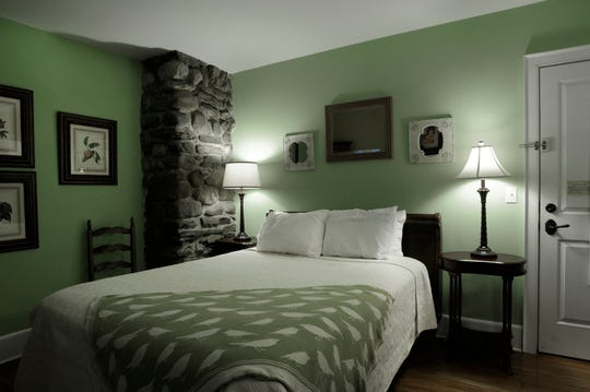 One of the guest rooms at The Buttermilk Falls Inn.